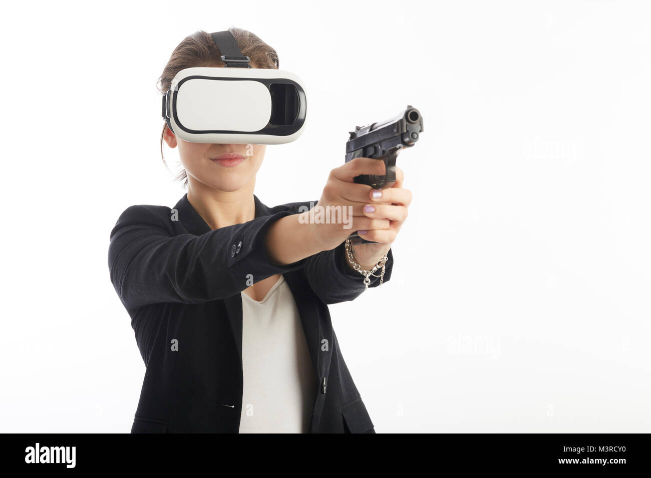 woman agent using virtual reality interface with gun Stock Photo