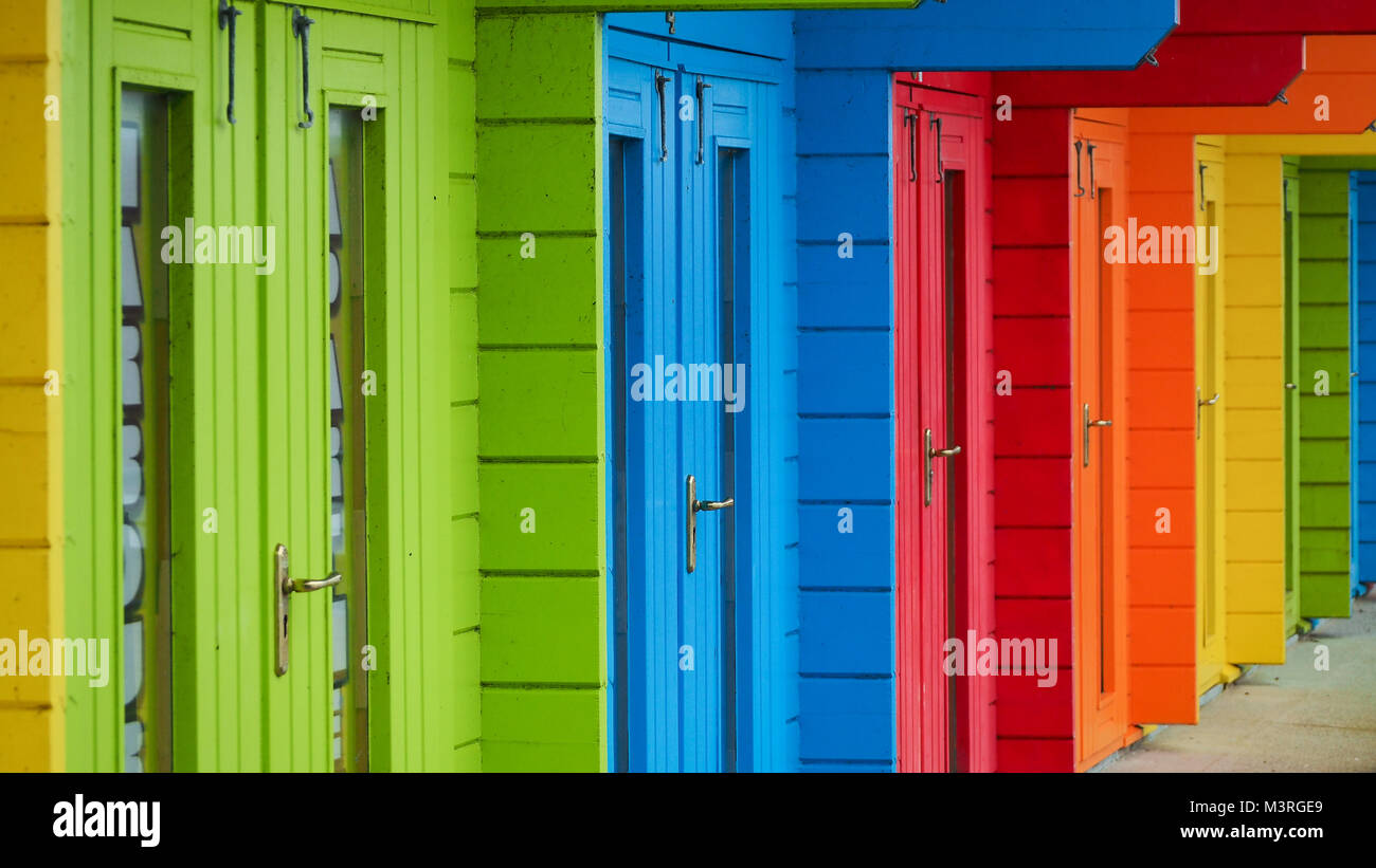 Colourful beach huts - Stock Image