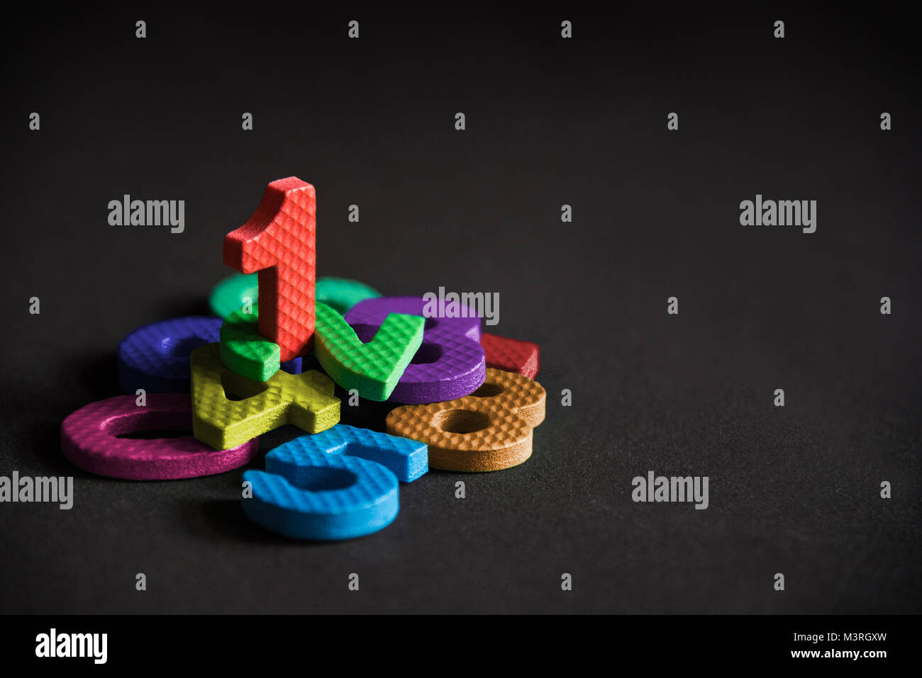 Business winner or leader, number one stand on the pile of number foam blocks, success, achievement concept background. - Stock Image