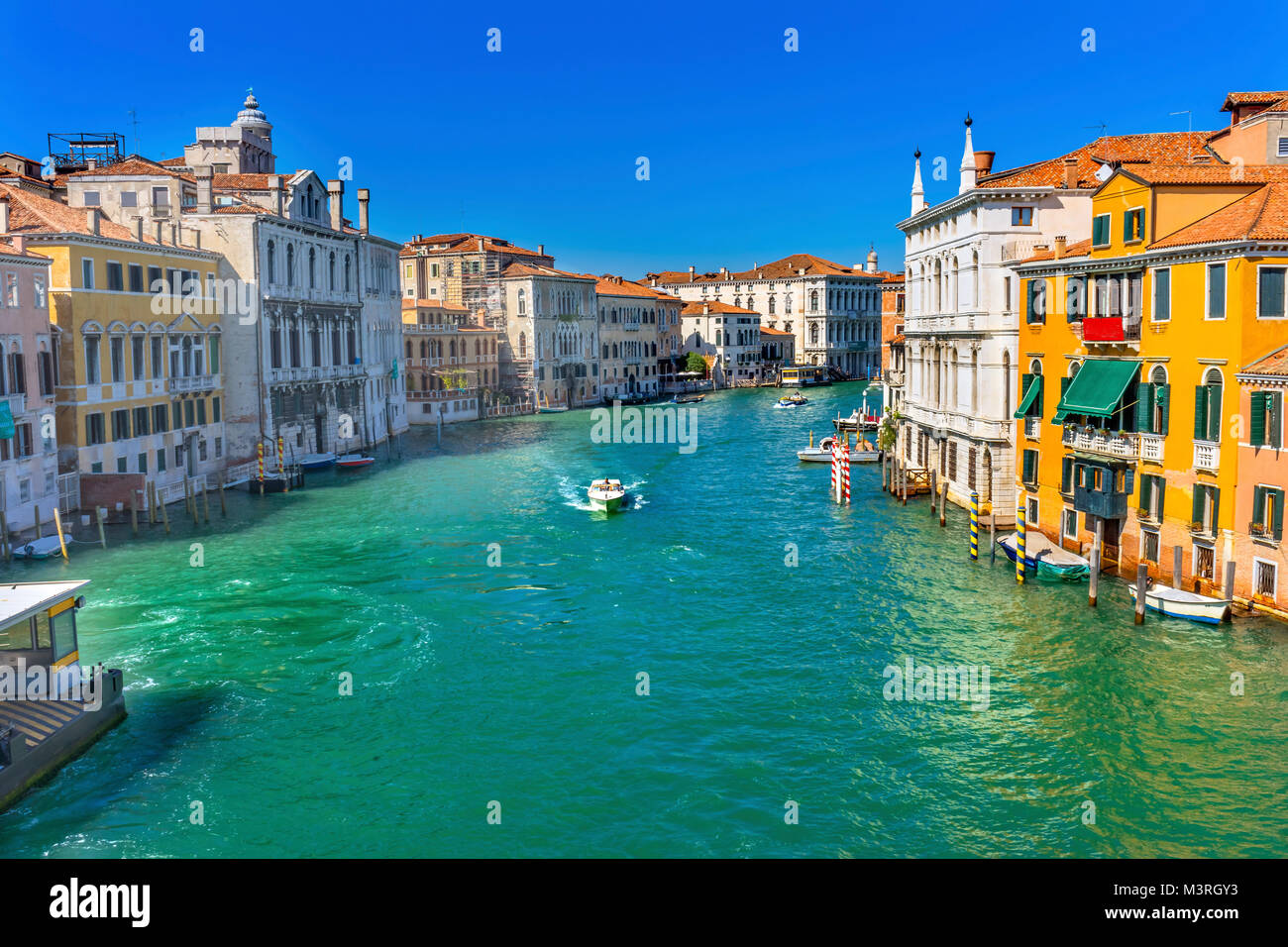 Colorful Grand Canal From Ponte Academia Bridge Buildings Ferry Boats Reflections Venice Italy - Stock Image