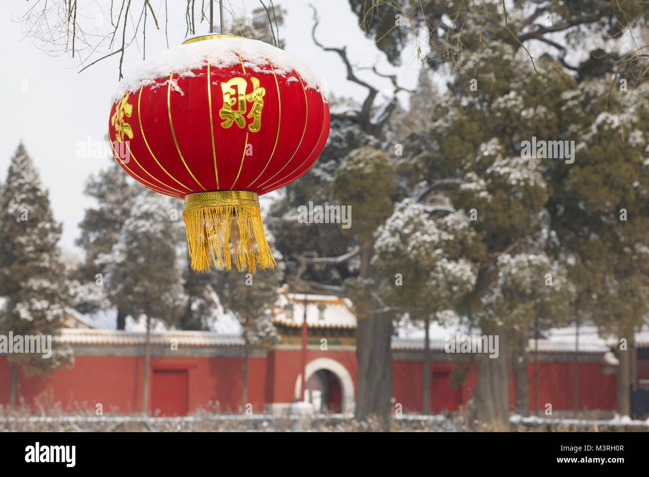 A Chinese Red Lantern for the New Year in the coal Hill park by a snowy day. Beijing, China. - Stock Image