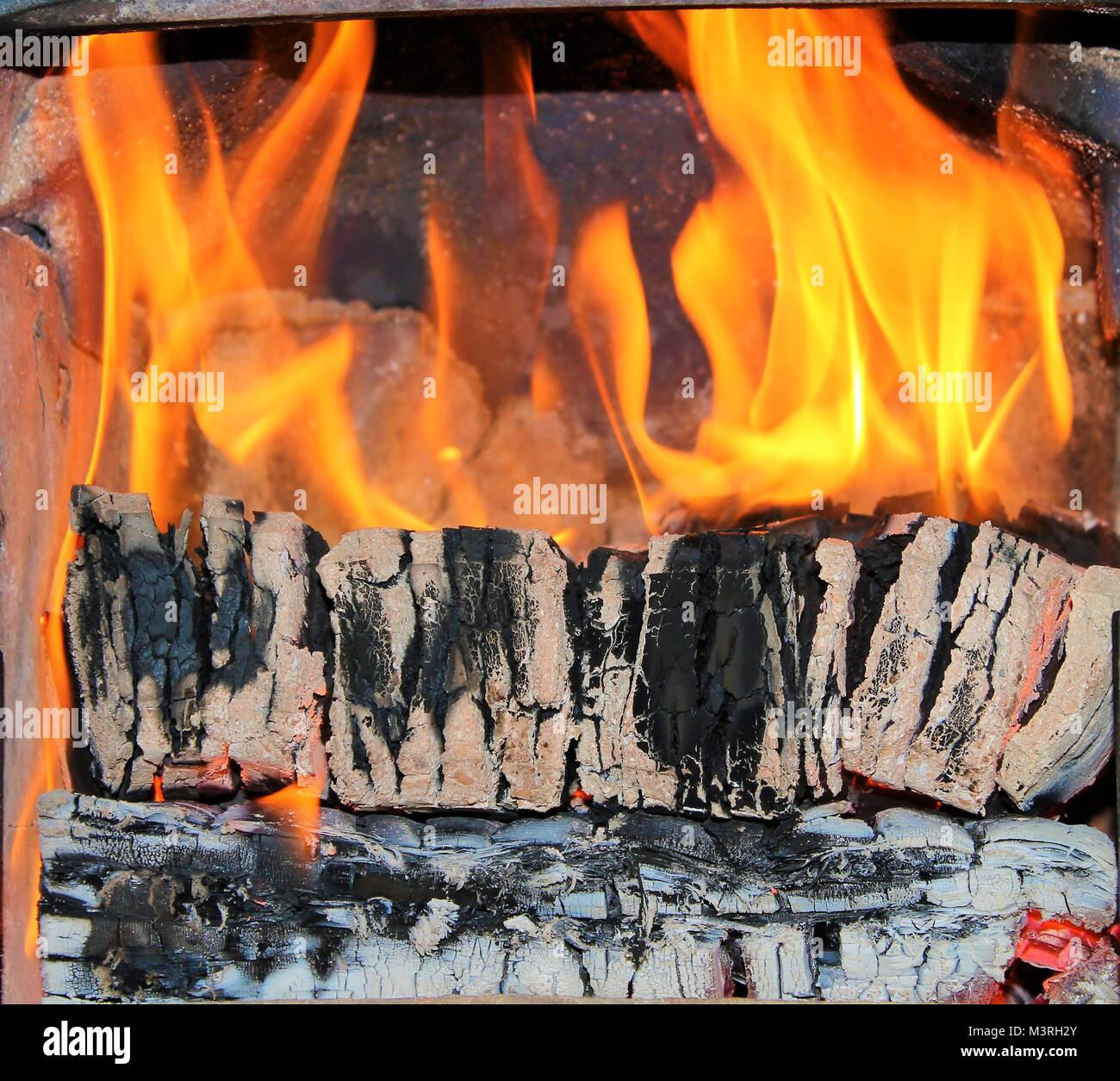 Peat Fire burning in domestic home fire place or fireplace - Stock Image