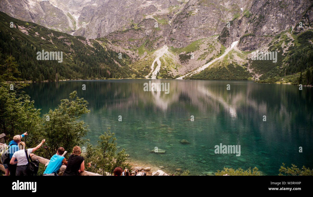 Polish Tatry Tatra,  crystal clear water lake / pond in the mountain valley on sunny autumn day. Water reflections, - Stock Image
