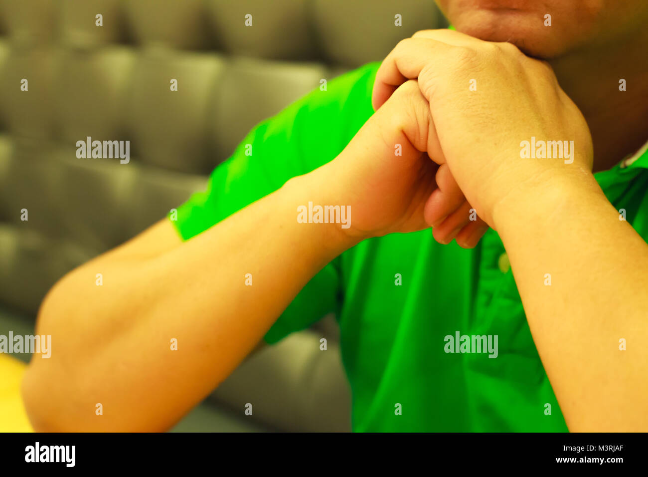 Man's Hands clenched in raised position, body language concept. - Stock Image