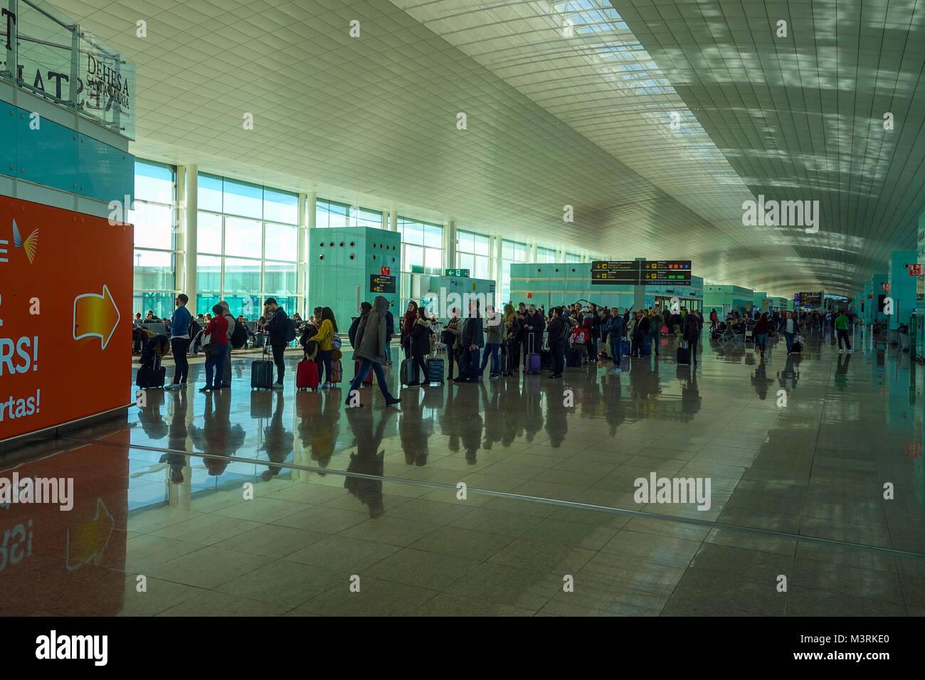 Barcelona El Prat airport with people queueing Stock Photo