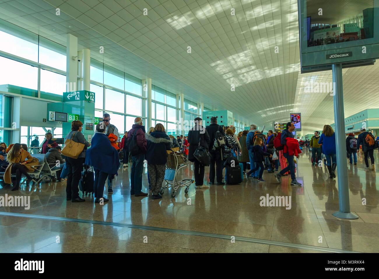 Barcelona El Prat airport with people queueing - Stock Image