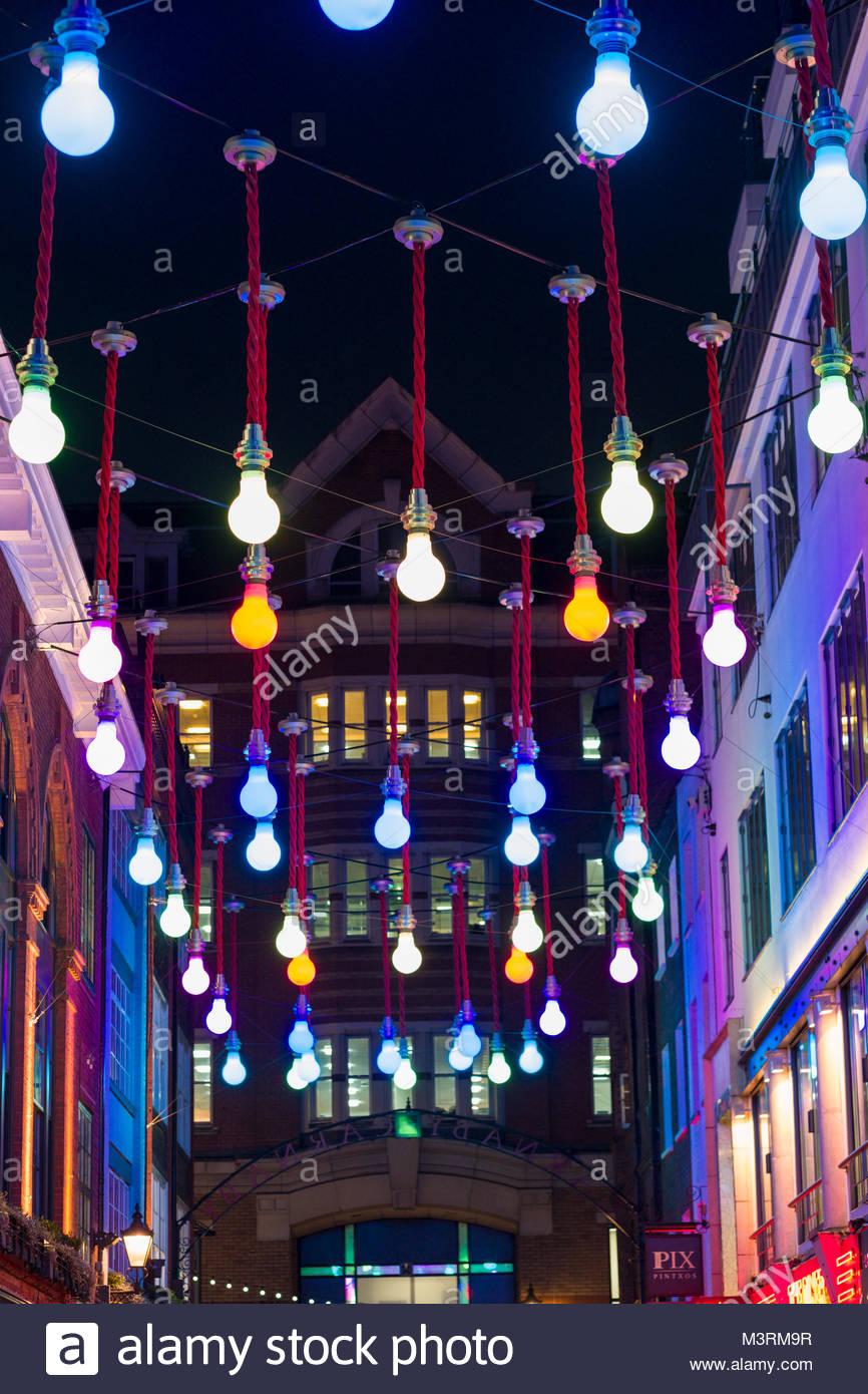 Art installation Oversized Light Bulbs above Ganton Street, Soho, City of Westminster, London, England, United Kingdom - Stock Image