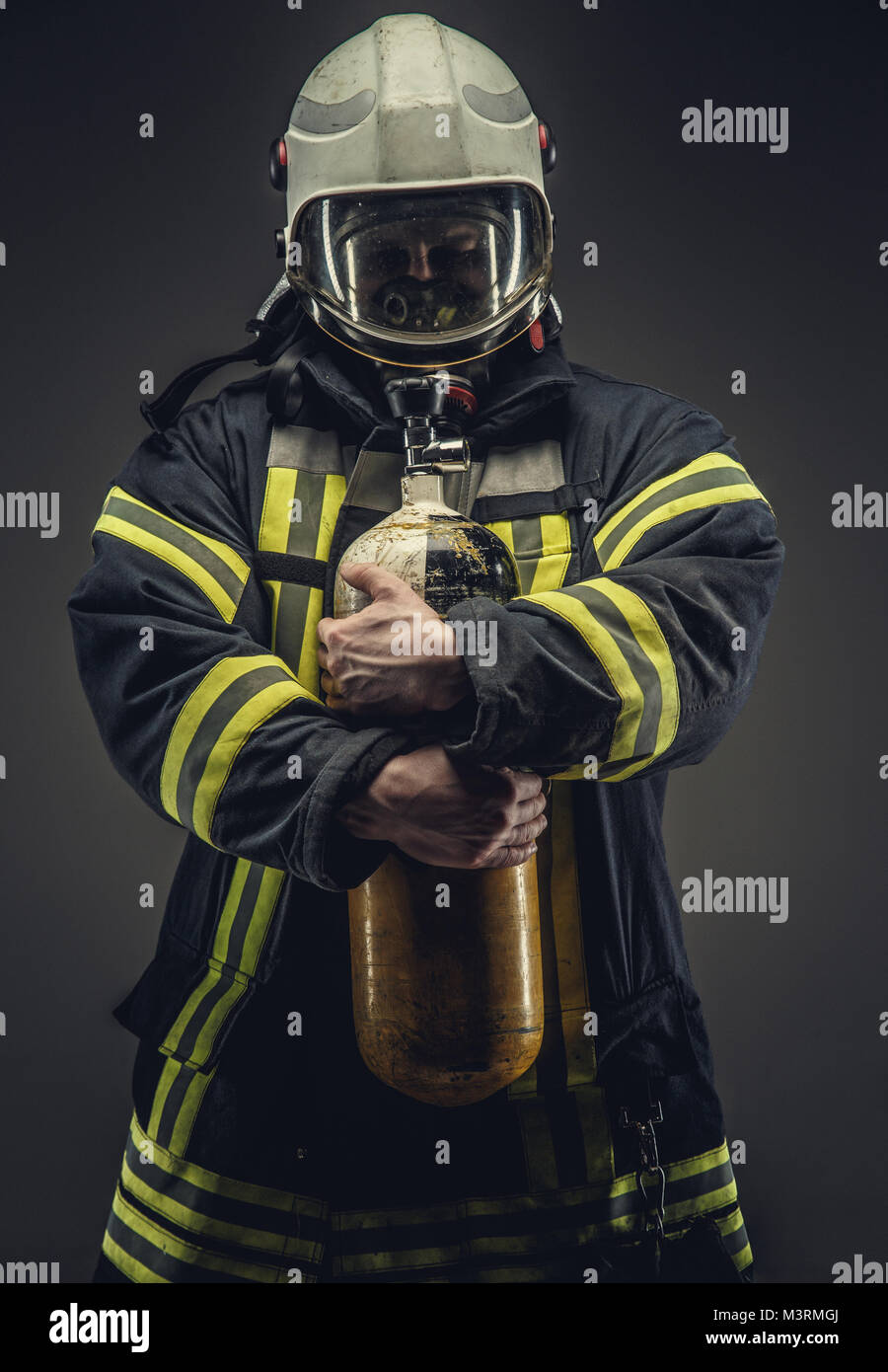 Portrait of firefighter in safety uniform. - Stock Image
