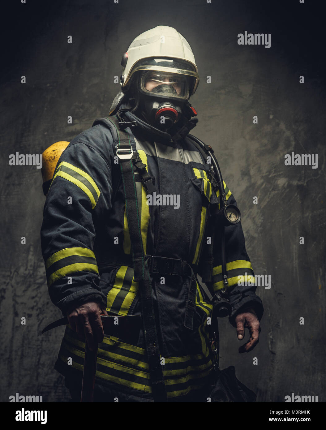 Portrait of firefighter in oxygen mask. - Stock Image