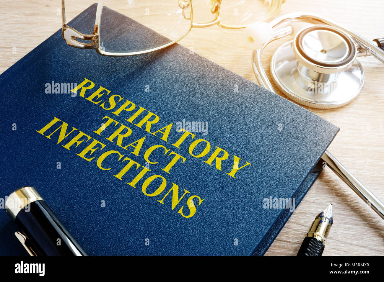Book about Respiratory tract infections and stethoscope. - Stock Image