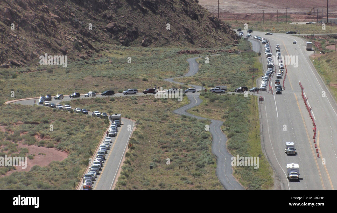 Memorial Day Weekend is our busiest weekend of the year. The Arches National Park entrance road backed up onto US Stock Photo