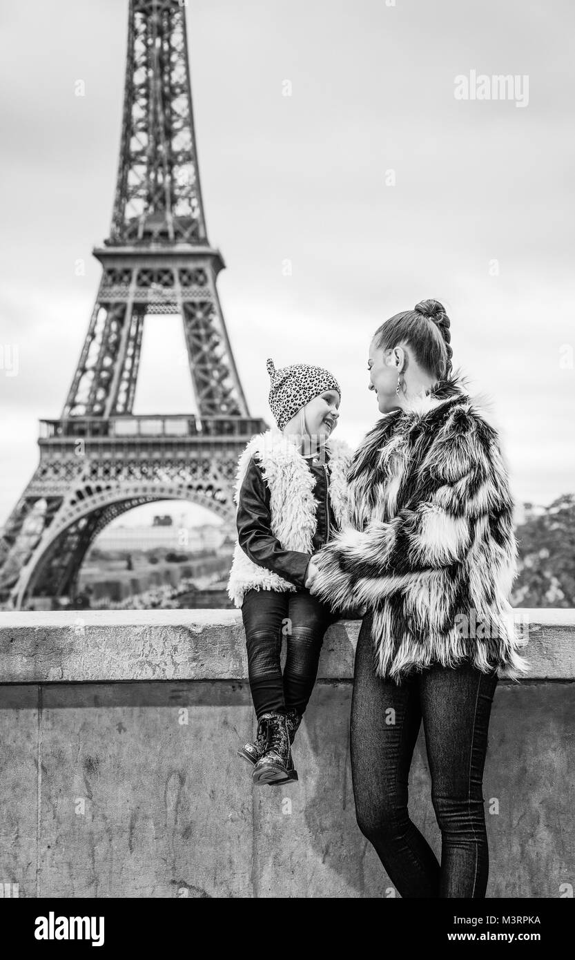 The Party Season in Paris. happy modern mother and child in Paris, France looking at each other - Stock Image