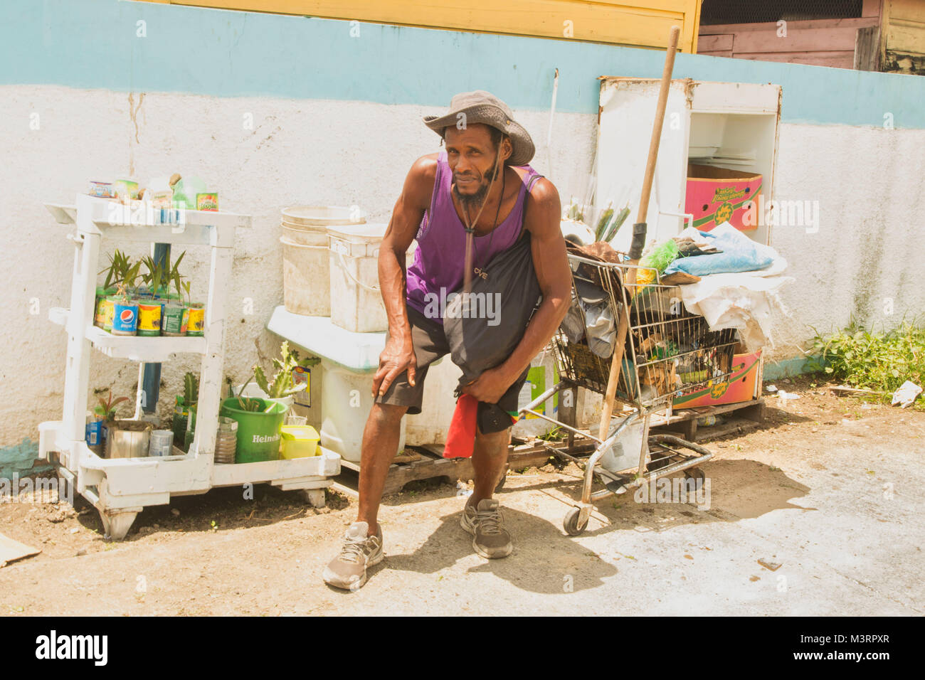 local character and goods beside Ocho Rios bus station, Jamaica, West Indies, Caribbean Stock Photo