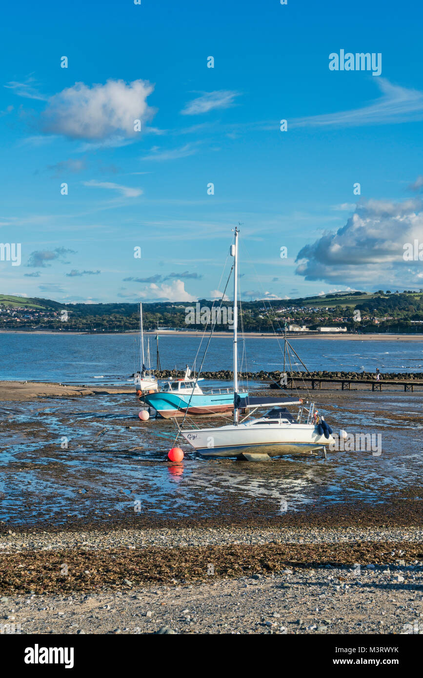 Boats on beach, Rhos on Sea, Colwyn Bay, seafront, north Wales, UK - Stock Image