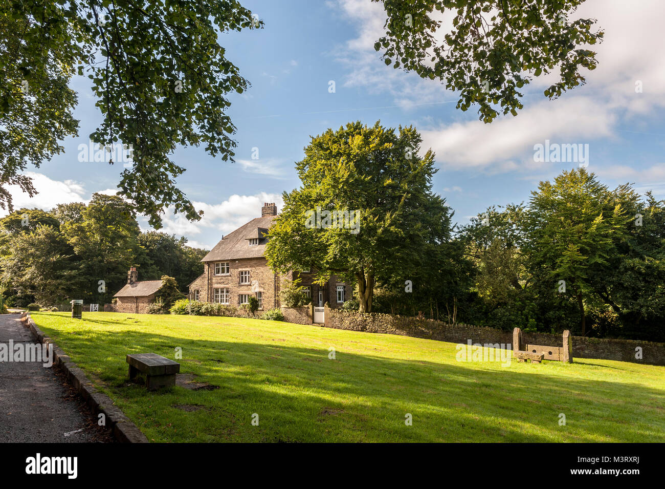 Rivington village green and stocks looking towards the Old Vicarage House  in the civil parish of the Borough of - Stock Image