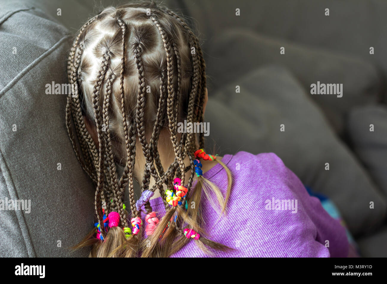 Close Up Of Braid Hair Of Little Girl With Colorful Rubber Bands