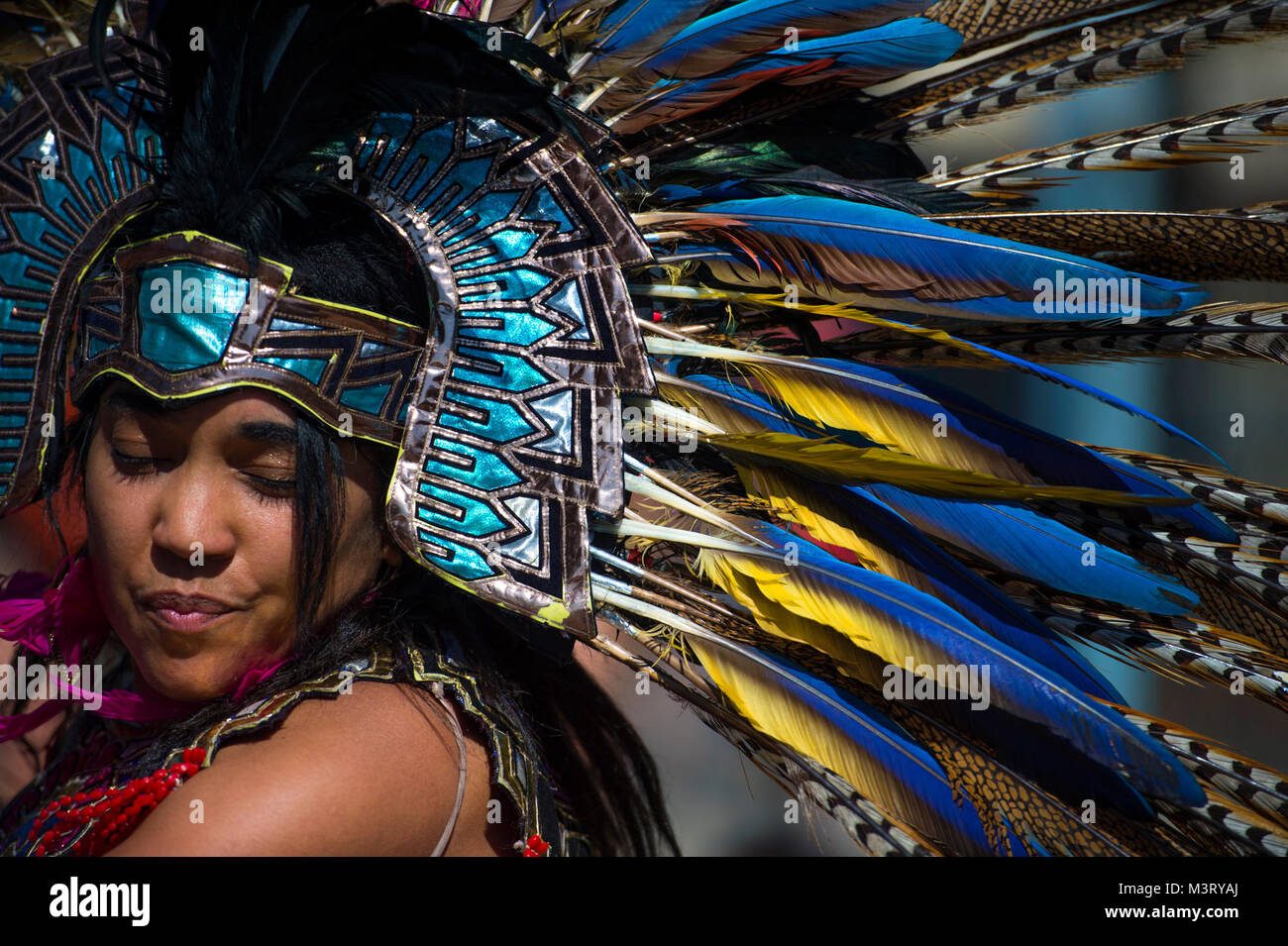 An Aztec heritage dancer wears traditional regalia for a performance during the annual Latino Heritage Festival Stock Photo