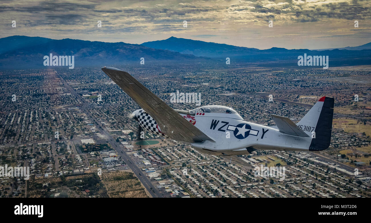 A P-51 Mustang flies around the airspace of Davis-Monthan Air Force Base on March 5, 2016. The P-51 was participating Stock Photo