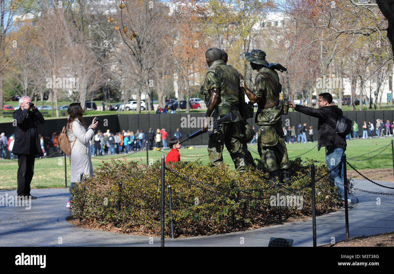 Visitors and tourist flock to the National Mall to visit the Three Servicemen (Sometimes called The Three Soldiers) Stock Photo