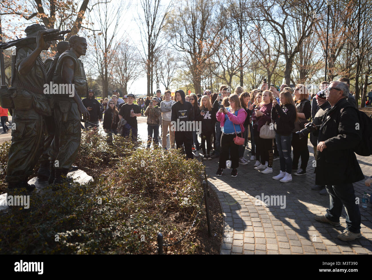 – Visitors and tourist flock to the National Mall to visit the Three Servicemen (Sometimes called The Three Soldiers) Stock Photo