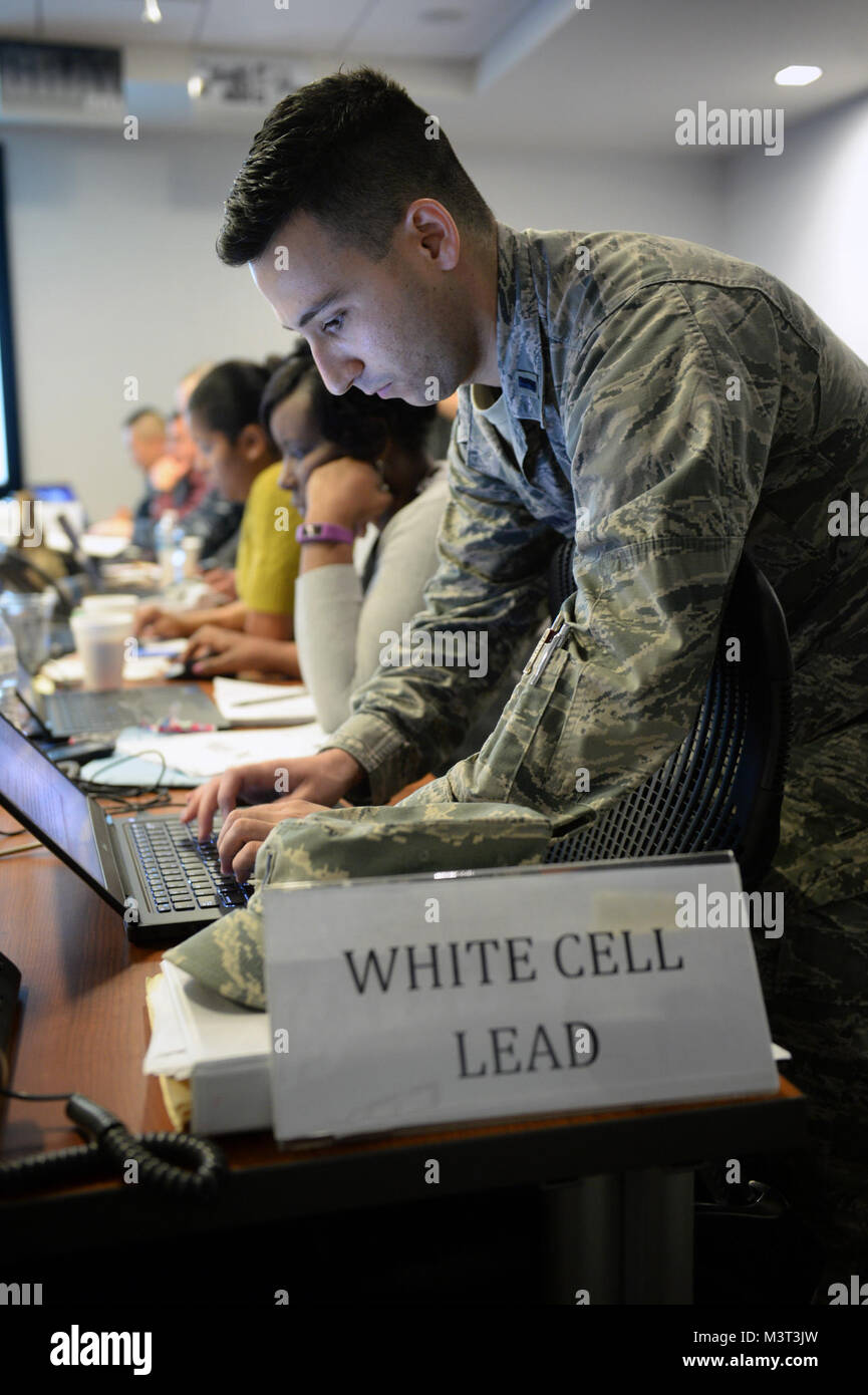U.S. Air Force 1st Lt. Frank Sclafani, White Cell Lead, conducts Cyber Defense Exercise operations with fellow team Stock Photo