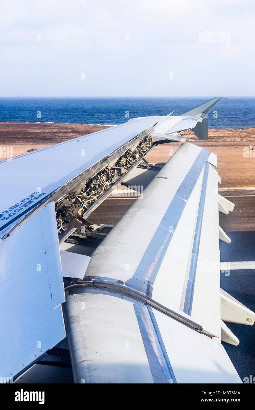 Flaps and air brakes fully employed on an Airbus 321 landing at Fuerteventura Airport, Canary Islands - Stock Image