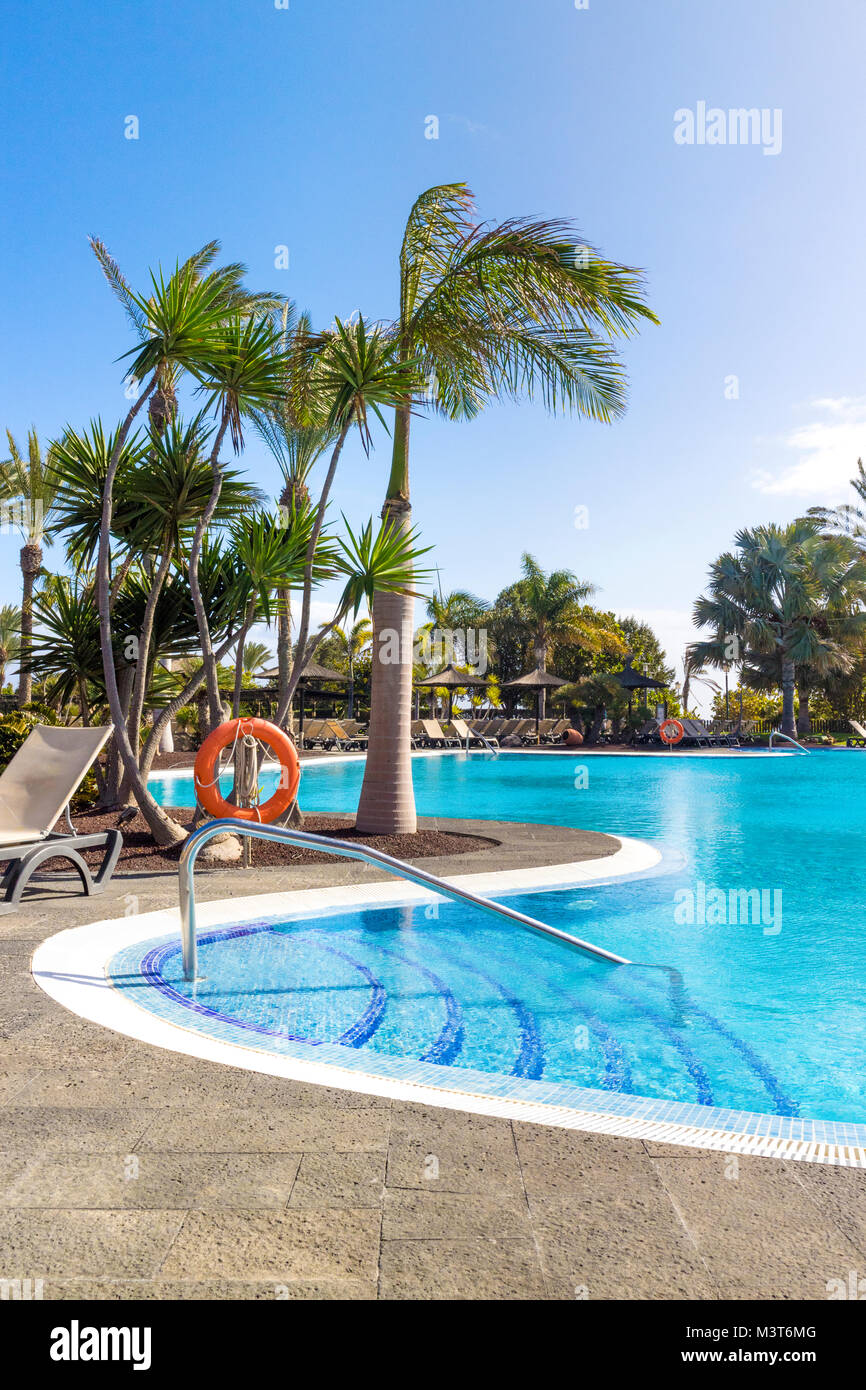A typical hotel swimming pool in the Canary Island of Fuerteventura - Stock Image