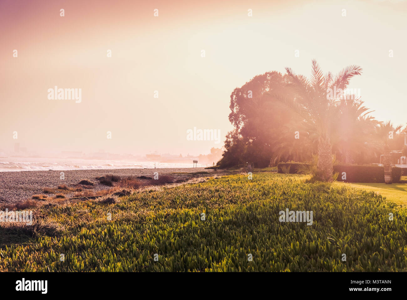 Perfect morning on the beach in Larnaca. Sunrise light and warm vintage tones. - Stock Image