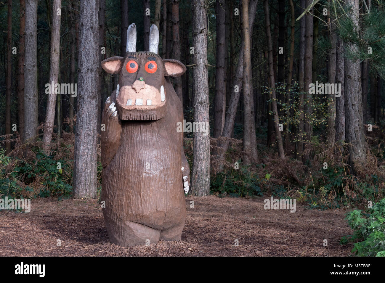 The Gruffalo Wood Carving on the Gruffalo Spotters Trail, Delamere Forest, Delamere, Cheshire, England, UK - Stock Image