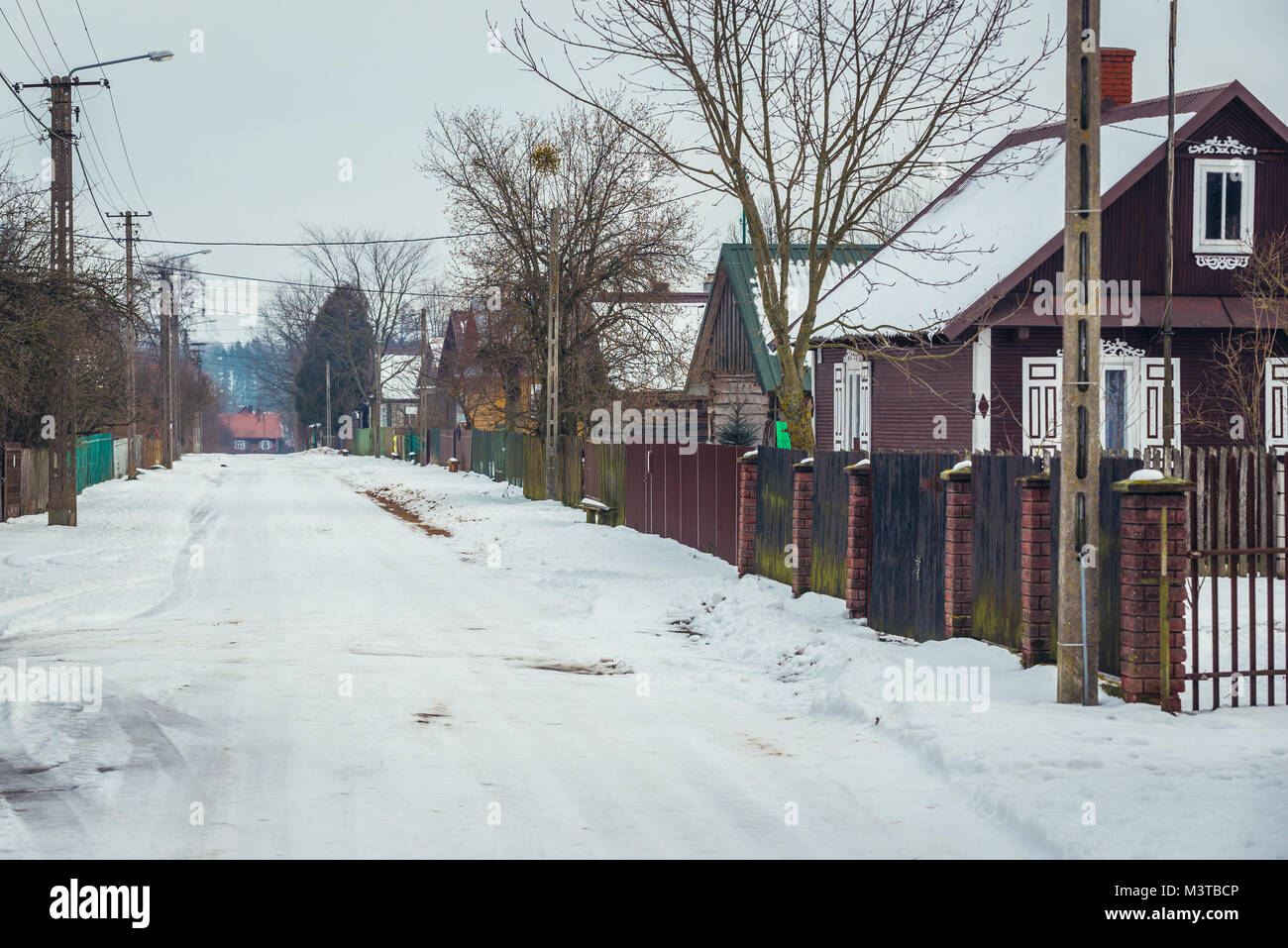 Wooden houses along road in Soce village on so called Land of Open Shutters trail, famous for traditional architecture - Stock Image
