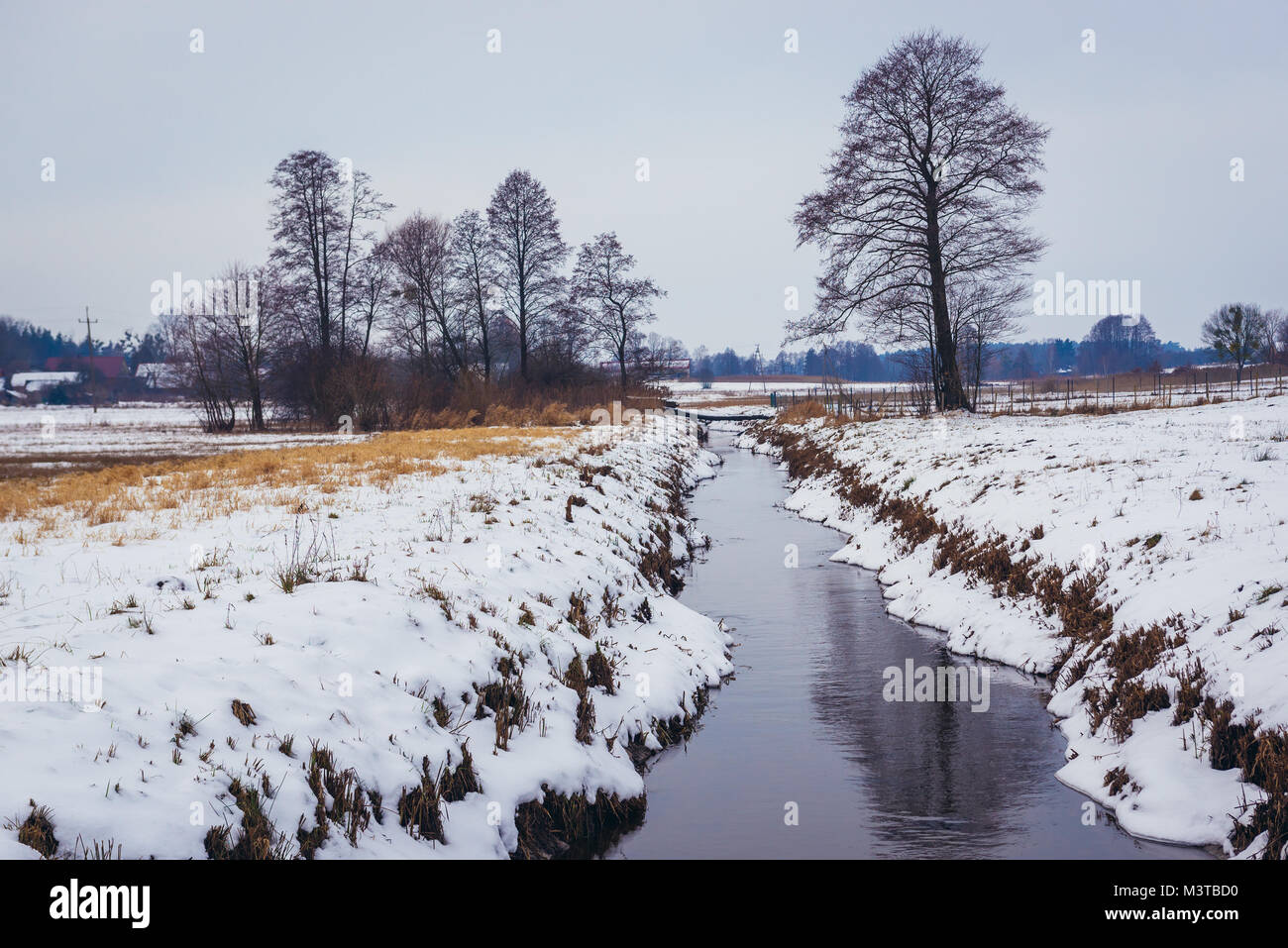 Rudnia river in Soce village on so called The Land of Open Shutters trail, famous for  traditional architecture - Stock Image