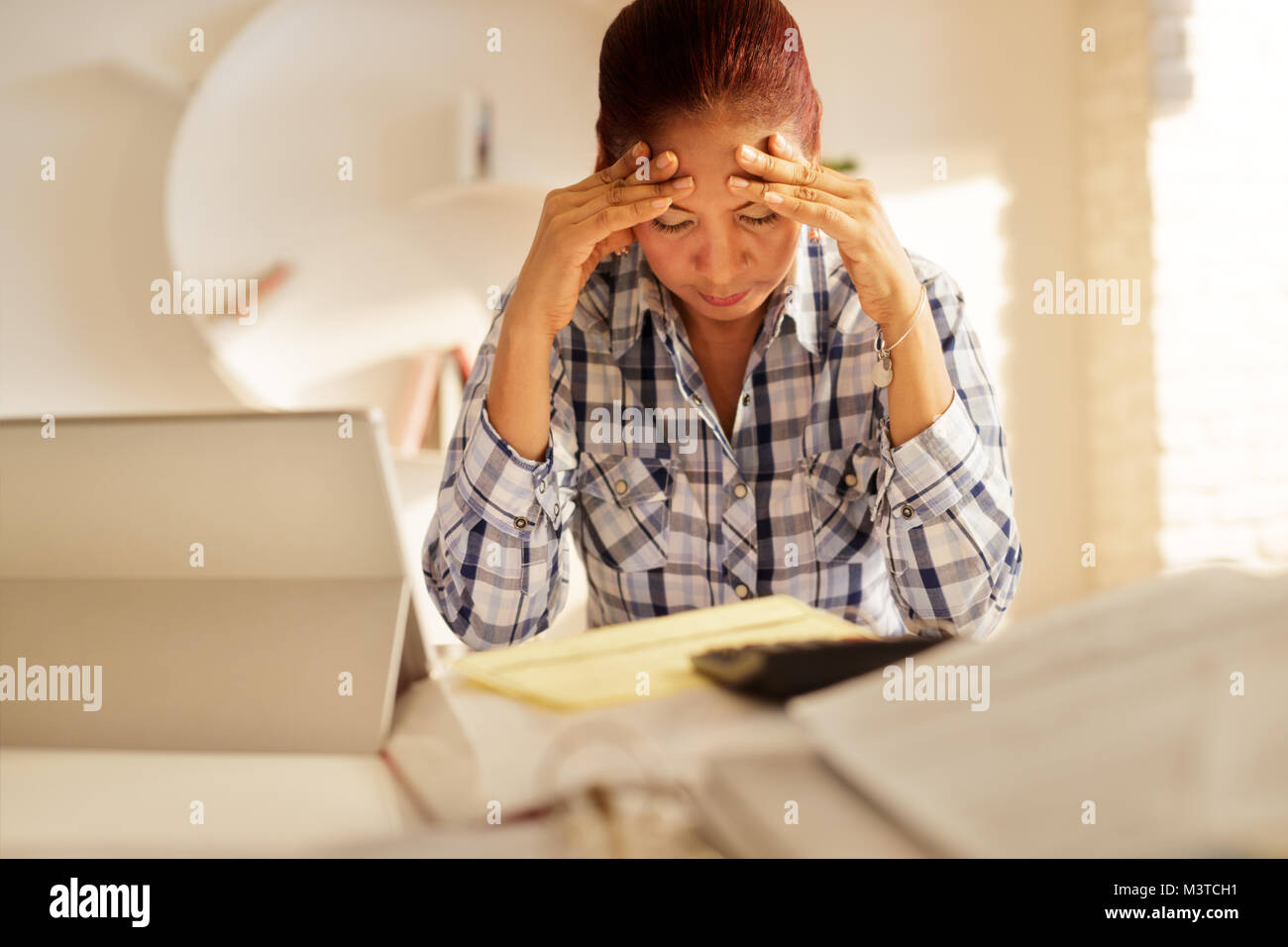 Angry Senior Woman Paying Bills And Filing Federal Tax Return - Stock Image