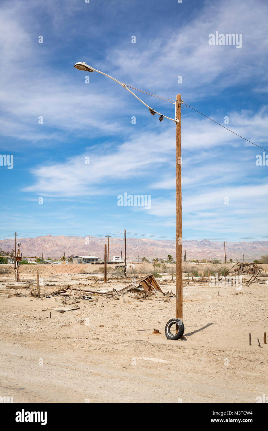 Light Pole and discarded trash at street corner in Bombay Beach, Salton Sea, California - Stock Image