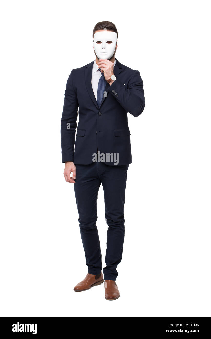 Businessman in formal wear holding mask, isolated on white - Stock Image