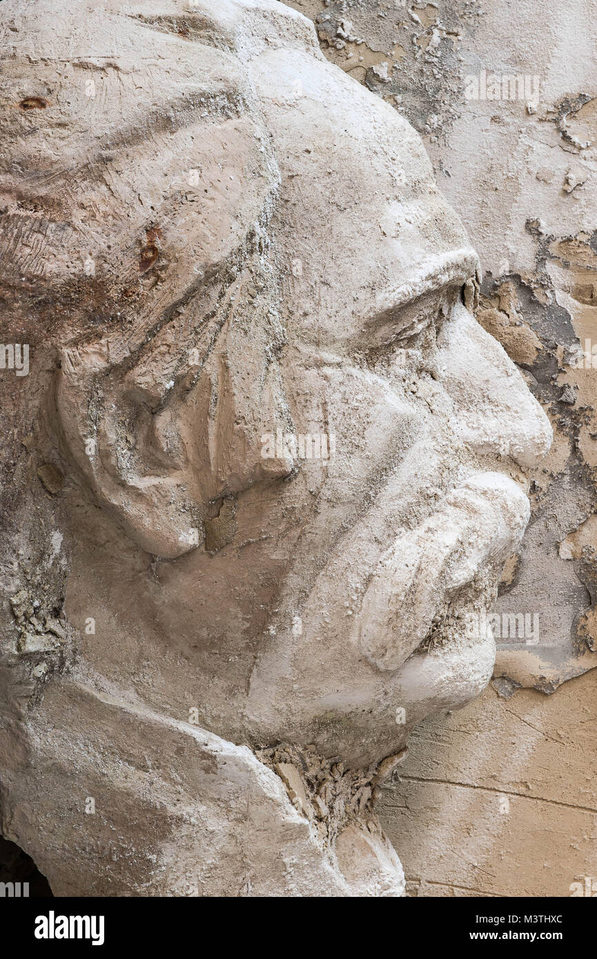 A casted head of loathed General Secretary Stalin in the corner of an abondoned swimmingpool in Dzhermuk. - Stock Image