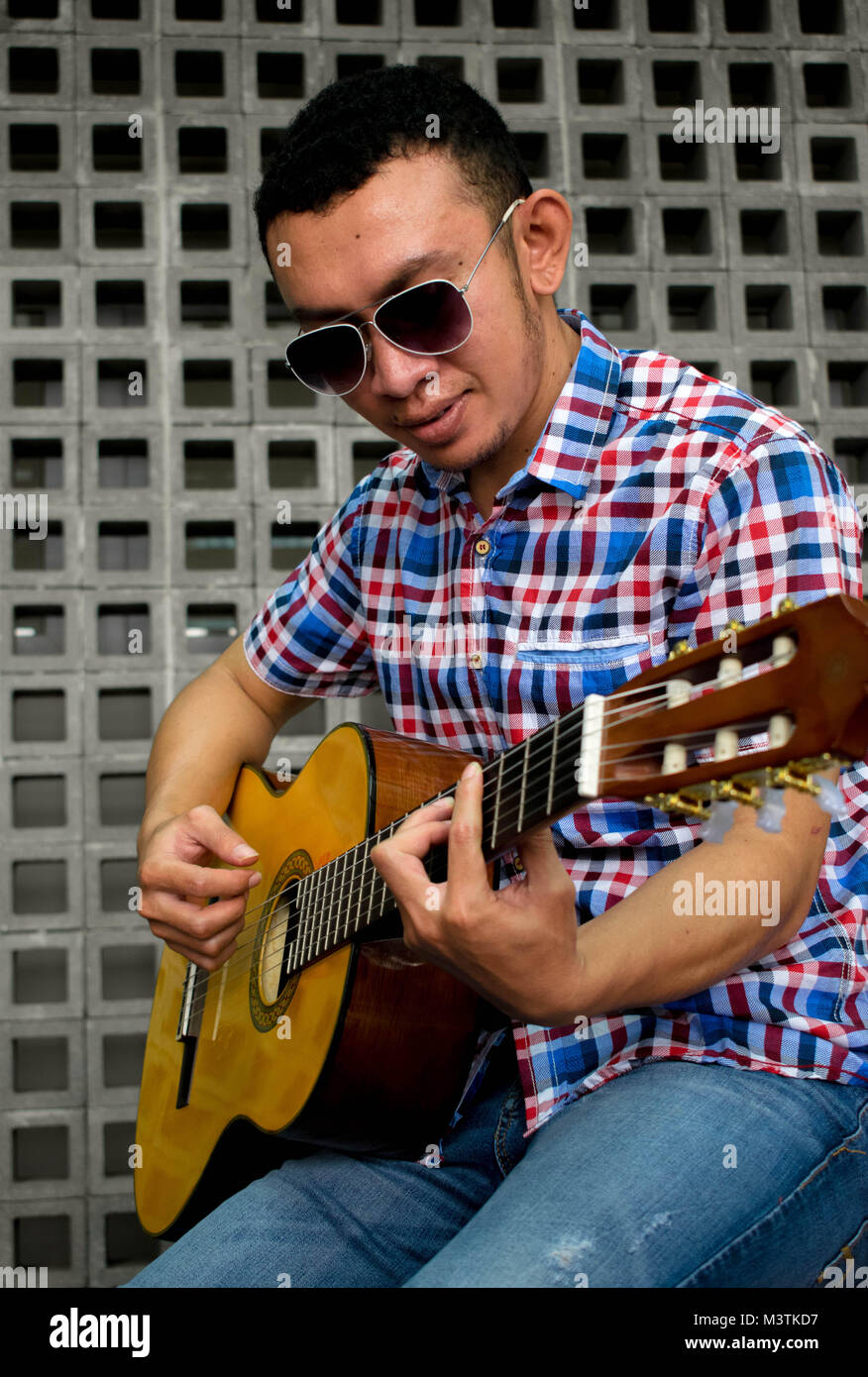 Cool guy playing guitar - Stock Image