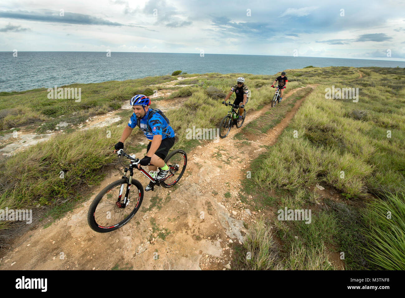 Supporters of Warriors 4 Life nonprofit veterans group ride alongside the ocean in Cabo Rojo, Puerto Rico Aug. 13, - Stock Image