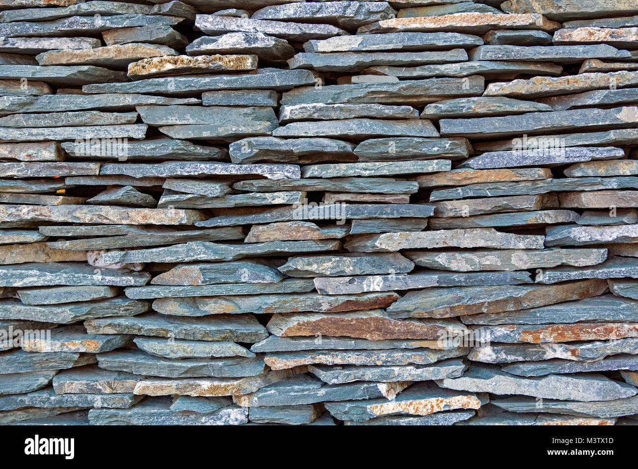 Wall built of dry laid bluestone, a common building and architectural matierial. - Stock Image