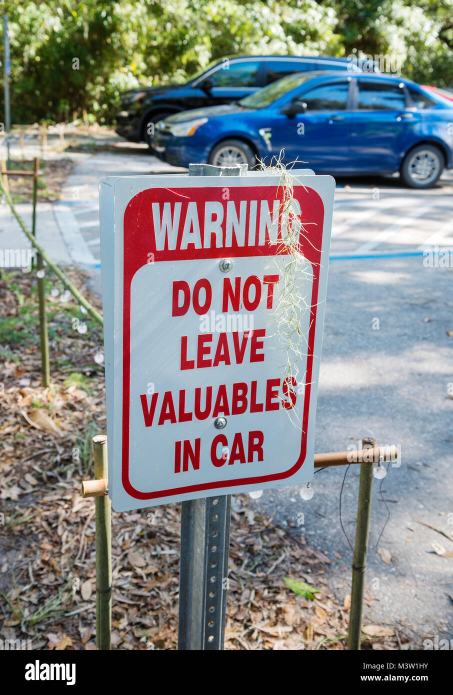 Sign warning against leaving valuables in a car or vehicle because of theft. - Stock Image