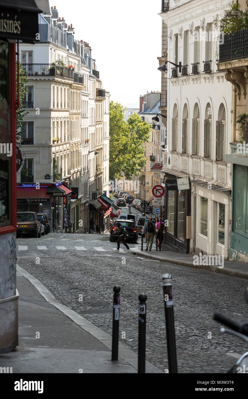 Montmartre in Paris. Montmartre area is most popular destinations in Paris, has lots of cozy cafes, restaurants, - Stock Image