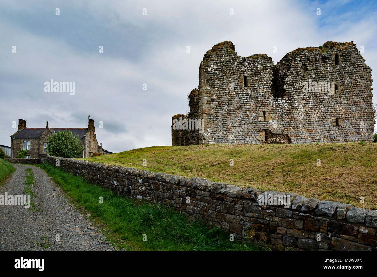 Ruins of Thirlwall Castle and stone cottage, near Greenhead, Northumberland, England, United Kingdom - Stock Image