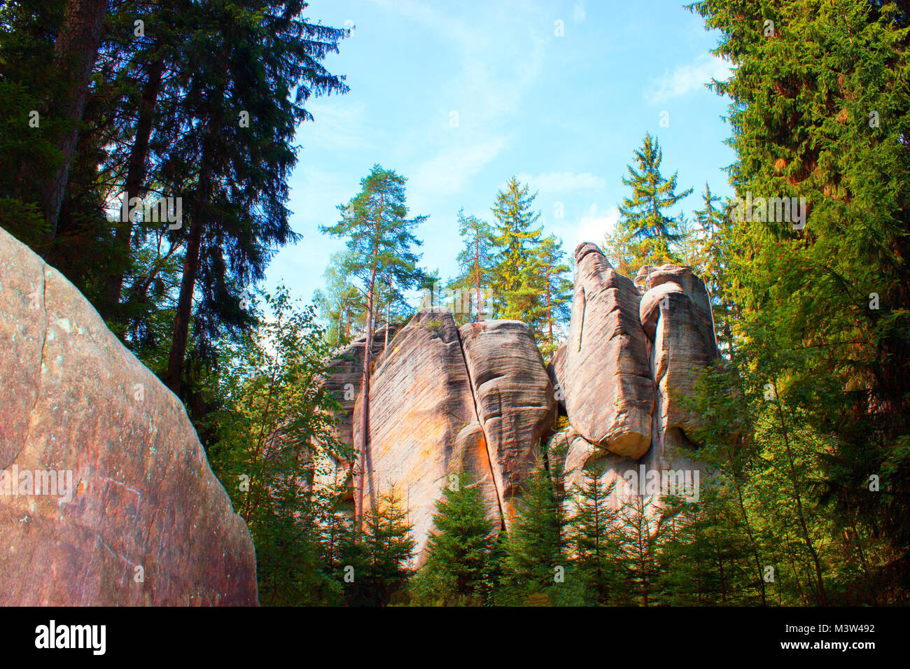 Right rock  is like the sculptures and in the background is the rock with trees. - Stock Image