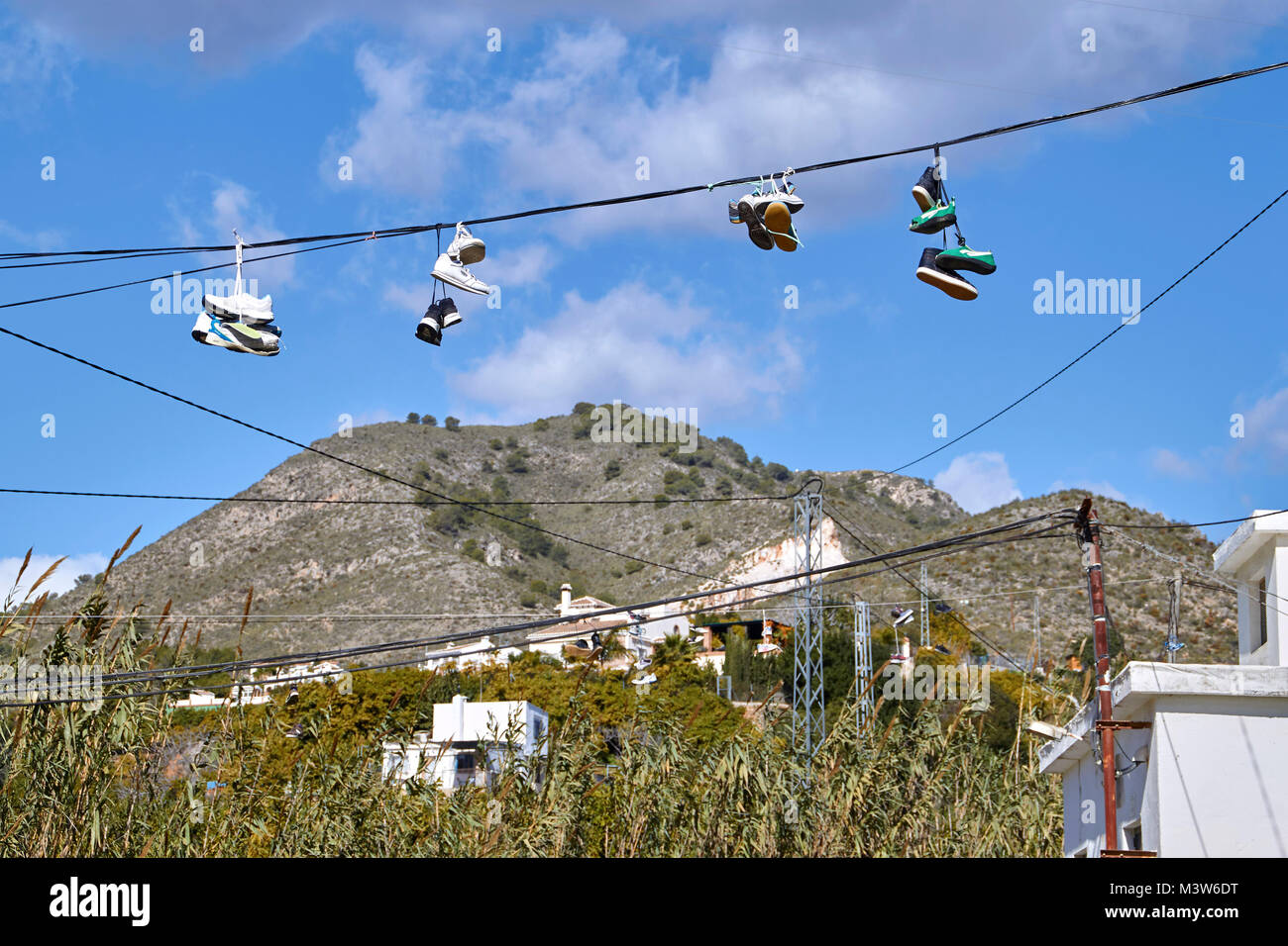 worn out shoes on a line, Rio Chillar, Andalusia, Spain - Stock Image