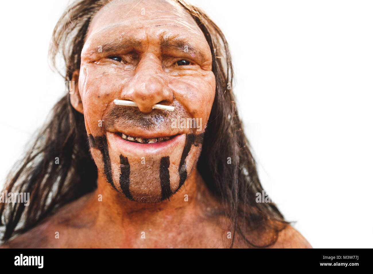 realistic prehistoric early man neanderthal reproduction portrait closeup - Stock Image