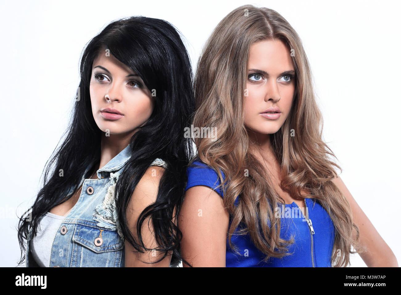 Two beautiful women standing back to back Stock Photo