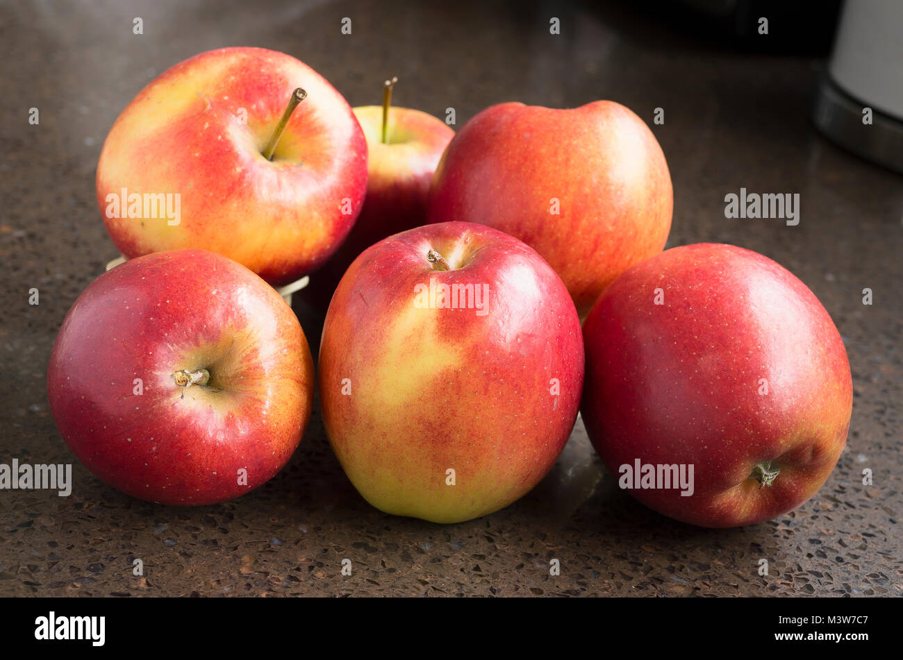 Jazz apples are crisp and juicy eating apples in an English winter - Stock Image