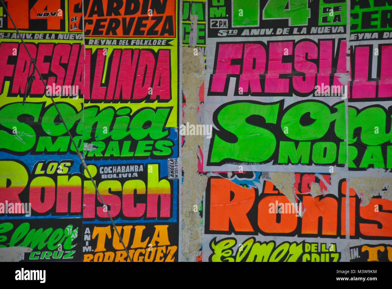 Colorful neon posters advertising the artists playing at traditional music nights in Peru - Stock Image
