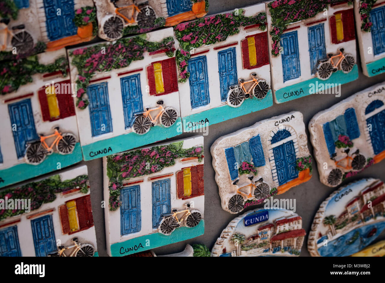 Close up view of many stone souvenirs of Cunda (Alibey) island. - Stock Image