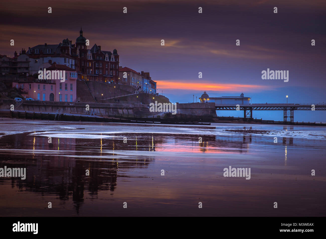 View of Cromer from the beach at sunset. - Stock Image