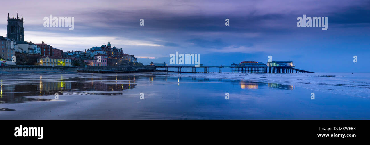 Panorama of Cromer from the beach at sunset. - Stock Image
